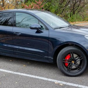 "Macan GTS front quarter profile with 19"" Turbo wheels painted black and winter tires"